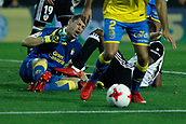9th January 2018, Mestalla Stadium, Valencia, Spain; Copa del Rey football, round of 16, second leg, Valencia versus Las Palmas; Geoffrey Kongdobia, midfielder for Valencia Cf treads on Raul Lizoain the goalkeeper for Las Palmas CF during the game