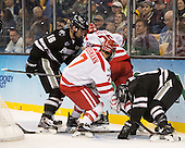 Anthony Florentino (PC - 16), Cason Hohmann (BU - 7), AJ Greer (BU - 26), Tom Parisi (PC - 6) - The Providence College Friars defeated the Boston University Terriers 4-3 to win the national championship in the Frozen Four final at TD Garden on Saturday, April 11, 2015, in Boston, Massachusetts.