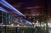 PARIS, FRANCE - JANUARY 19: A high angle view of the Funicular Railway on January 19, 2009, in Montmartre, Paris, France. The train passes the camera in a streak of light down the hill beside a staircase bordered by trees and streetlights on a winter evening. The Funicular Railway originally opened in 1900 and was rebuilt in 1990. (Photo by Manuel Cohen)