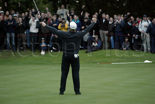 17 October 2004: South African golfer ERNIE ELS (RSA) celebrates holing a long putt on the 17th green to win the HSBC World Matchplay Championships played at Wentworth, Surrey. Els beat Lee Westwood 2 and 1 in the final. Els has now won the title a record six times. Photo: Glyn Kirk/Action Plus...041017 golf joy celebrate celebration celebrations player