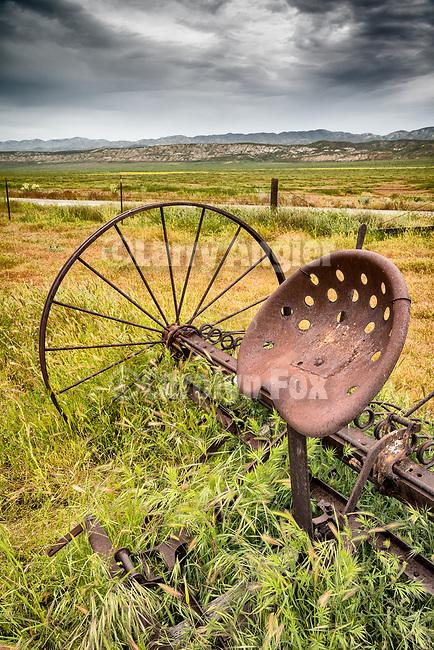Iron seat of a sulky rake, abandoned mid 20th century farm at the Traver Ranch, Carrizo Plain National Monument, San Luis Obispo County, Calif.