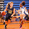 Brenna Farrington #40 of Northport, left, gets pressured by Keyanah Jackson #13 of Copiague during a Suffolk County League II varsity girls' basketball game at Copiague High School on Thursday, Jan. 28, 2016. Copiague won by a score of 59-52.