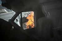 In this Tusday, Jun. 11, 2013 photo, a police canyon truck set up in fire burns during clashes between protesters and the anti-riot police at the streets of Taksim Square in Istanbul,Turkey. (Photo/Narciso Contreras).