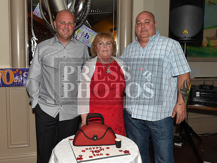 Ena Holmes celebrating her 70th birthday in the Thatch with her sons Lee and Paul. Photo:Colin Bell/pressphotos.ie