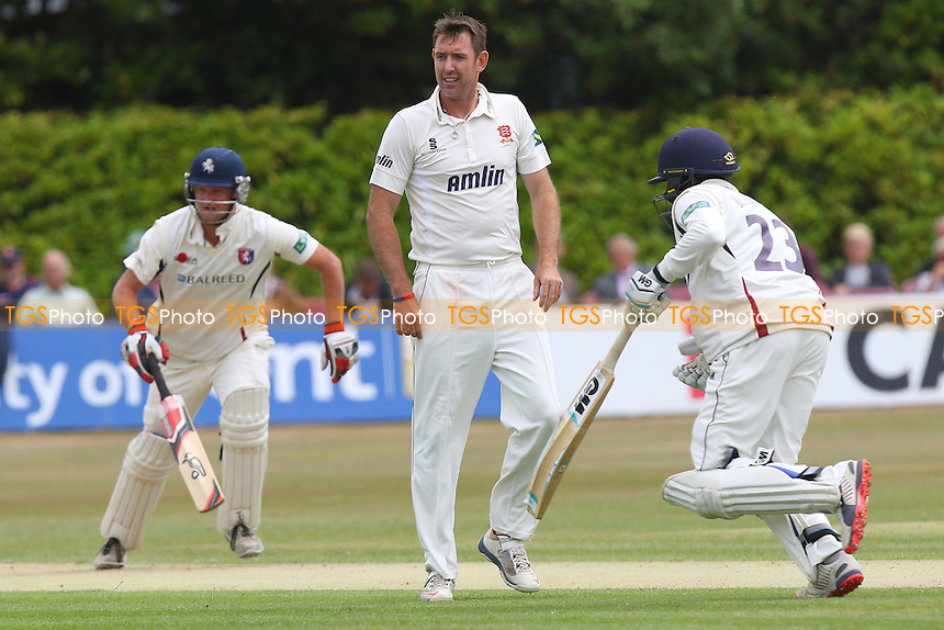 David Masters of Essex CCC (C) can only watch as Rob Key (L) and Daniel Bell-Drummond add to the Kent total