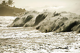 USA, Hawaii, surfer tries to outrun a huge wall of white water at Waimea Bay (B&W)