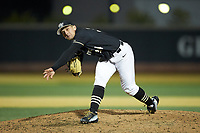 Wake Forest Demon Deacons relief pitcher Bobby Hearn (34) follows through on his delivery against the Illinois Fighting Illini at David F. Couch Ballpark on February 16, 2019 in  Winston-Salem, North Carolina.  The Fighting Illini defeated the Demon Deacons 5-2. (Brian Westerholt/Four Seam Images)
