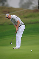 Marcel Siem (GER) putts on the 5th green during Saturay's Round 3 of the 2014 BMW Masters held at Lake Malaren, Shanghai, China. 1st November 2014.<br /> Picture: Eoin Clarke www.golffile.ie