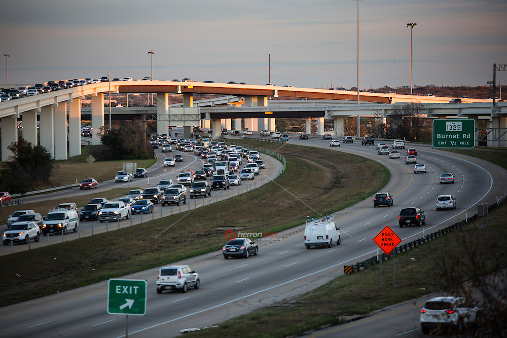"""Evening commuter traffic fills the """"Spaghetti Highway"""" Mopac exchange in northwest Austin, connects Highway 183, Mopac Loop 1 and Loop 360, the Capital of Texas Highway."""