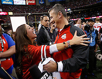 Ohio State Buckeyes head coach Urban Meyer celebrates with his daughter Nicki following Ohio State's win over Alabama in the Allstate Sugar Bowl college football playoff semifinal at the Mercedes-Benz Superdome in New Orleans on Jan. 1, 2015. (Adam Cairns / The Columbus Dispatch)