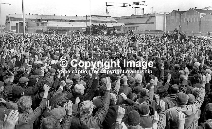 With a show of hands a majority of Belfast, N Ireland's shipyard workers attending a 3rd May 1977 well-supported meeting, vote against supporting the UUAC promoted general strike. The meeting was addressed by shop steward Sandy Scott. 197706030111<br /> <br /> Copyright Image from Victor Patterson,<br /> 54 Dorchester Park, <br /> Belfast, UK, BT9 <br /> <br /> t1: +44 28 9066 1296 (from Rep of Ireland 048 90661296)<br /> t2: +44 28 9002 2446 (from Rep of Ireland 048 9002 2446)<br /> <br /> m: +44 7802 353836<br /> <br /> e: victorpatterson@me.com<br /> www.victorpatterson.com<br /> <br /> Please see my Terms and Conditions of Use at www.victorpatterson.com. It is IMPORTANT that you familiarise yourself with them.<br /> <br /> Images used on the Internet must be visibly watermarked i.e. &copy; Victor Patterson<br /> within the body of the image and copyright metadata must not be deleted. Images <br /> used on the Internet have a size restriction of 4kbs and will be chargeable at current<br />  NUJ rates unless agreed otherwise.<br /> <br /> This image is only available for the use of the download recipient i.e. television station, newspaper, magazine, book publisher, etc, and must not be passed on to any third <br /> party. It is also downloaded on condition that each and every usage is notified within 7 days to victorpatterson@me.com<br /> <br /> The right of Victor Patterson to be identified as the author is asserted in accordance with The Copyright Designs And Patents Act (1988). All moral rights are asserted.