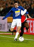 Nederland, Rotterdam, 30 oktober 2013<br /> KNVB Beker<br /> Seizoen 2013-2014<br /> Feyenoord-HSV Hoek<br /> Elvis Manu (r.) van Feyenoord en Fabian Wilson (l.) van HSV Hoek strijden om de bal.