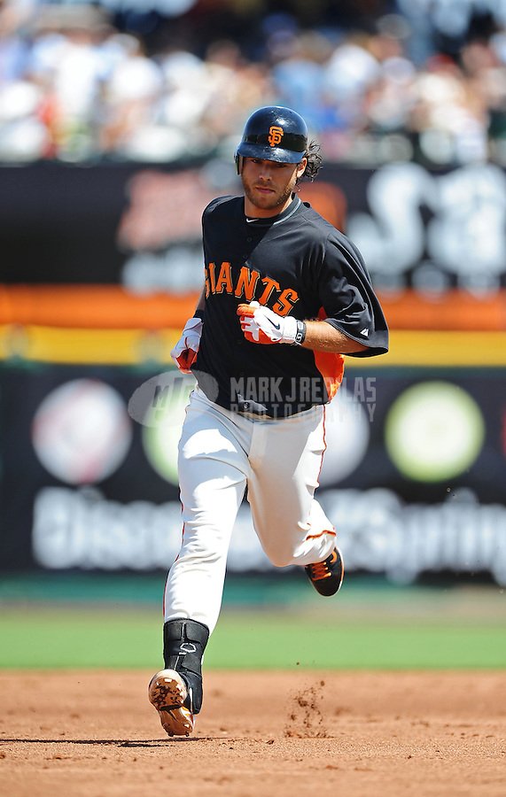 Mar. 28, 2012; Scottsdale, AZ, USA; San Francisco Giants shortstop Brandon Crawford rounds the bases after hitting a solo home run in the second inning against the Los Angeles Dodgers at Scottsdale Stadium.  Mandatory Credit: Mark J. Rebilas-