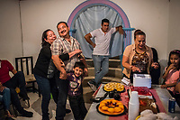 Carlos Saldaña is held back by his sister María Isabel Saldaña Grajales and Vicky;s grandson Adolfo, as Vicky Saldana and othe rfamily members look on during a birthday party for their grandson, Hector Yael, 10, at a family gathering at Vicky's daughter, Cinthia Hernández Delgadilo's house in Xalapa, Mexico on November 4, 2017. <br /> Photo Daniel Berehulak for The New York Times