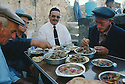 Turkey 1995.In Midin, one of the last Syriac Christian village of Tour Abdin, a priest having lunch with some villagers.Turquie 1995.A Midin, l'un des derniers villages chretiens de la region de Tour Abdin, un pretre dejeune avec des villageois