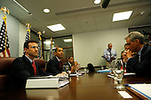 Washington, DC - January 6, 2009 -- United States President-elect Barack Obama meets with his economic team on Tuesday, January 6, 2009. The meeting included Rahm Emanuel, Chief of Staff-designate (R); Timothy Geithner, Treasury Secretary-designate (unseen); Peter Orszag, Director-designate, Office of Management and Budget (L); Rob Nabors, Deputy Director-designate, Office of Management and Budget (3L); Christina Romer, Director-designate, Council of Economic Advisors (2R) and Lawrence Summers, Director-designate, National Economic Council (3R). During the meeting they reviewed the medium-term budget outlook and discussed their willingness to craft a budget that will reduce the deficit as the economy recovers..Credit: Aude Guerrucci - Pool via CNP