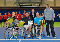 December 20, 2014, Rotterdam, Topsport Centrum, Lotto NK Tennis, Mens doubles wheelchair final,  winners Maikel Scheffers (L) with his partner Rick Molier,in the middle KNLTB director Erik Poel, next to him runners up Ronald Vink and Rick Molier<br /> Photo: Tennisimages/Henk Koster