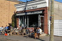 People relaxingat the Cafe Saint Henri coffee shop across from the Jean Talon Market, Montreal, Quebec Canada
