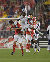 New England Revolution midfielder Sainey Nyassi (14), SL Benfica midfielder Filipe Menezes (24) and SL Benfica defender César Peixoto (25) battle for head ball. SL Benfica  defeated New England Revolution, 4-0, at Gillette Stadium on May 19, 2010.