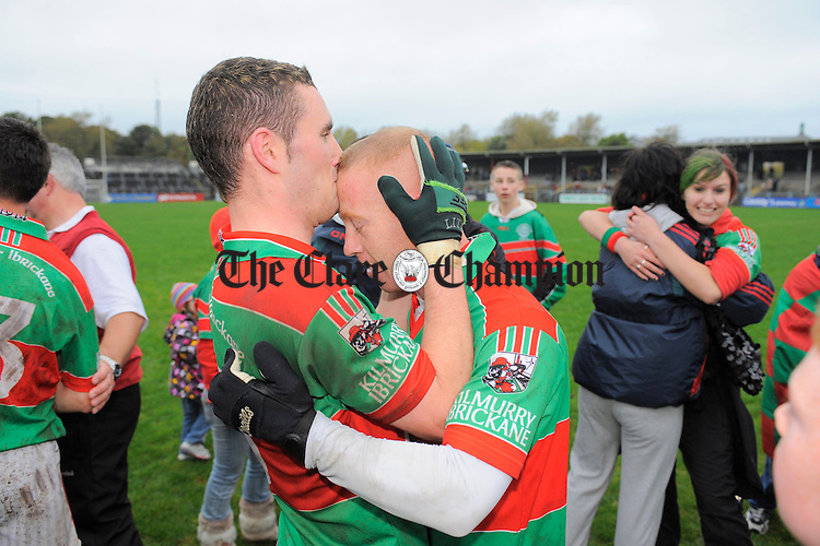 Kilmurry Ibrickane captain Shane Hickey with player Michael Hogan after the game. Photograph by John Kelly.