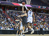 Washington, DC - March 11, 2018: Rhode Island Rams guard E.C. Matthews (0) blocks Davidson Wildcats guard Rusty Reigel (32) shot during the Atlantic 10 championship game between Rhode Island and Davidson at  Capital One Arena in Washington, DC.   (Photo by Elliott Brown/Media Images International)