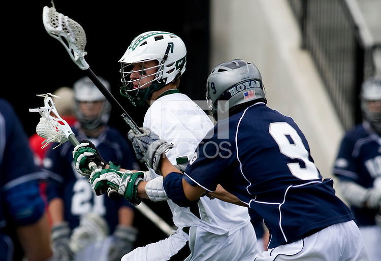 Davis Butts (7) of Loyola moves into the offensive zone while being defended by Chris Schuville (9) of Georgetown at the Ridley Athletic Complex in Baltimore, MD.  Loyola defeated Georgetown, 11-6.