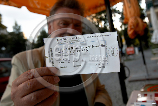 """BERLIN - GERMANY 23. JUNE 2007 -- Dieter Struzak shoving his 50 euro ticket for the theater play Wallenstein which plays for ten hours - about the the end of the Thirty Years War written by Friedrich Schiller set up by Berliner Ensemble in the former brewery factory of Berliner Kindl with the austrian actor Klaus Maria Brandauer in the main role  -- PHOTO: CHRISTIAN T. JOERGENSEN / EUP & IMAGES....This image is delivered according to terms set out in """"Terms - Prices & Terms"""". (Please see www.eup-images.com for more details)"""