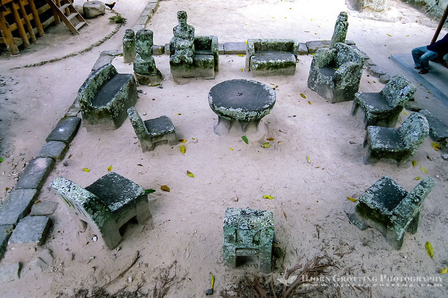 Indonesia, Sumatra. Samosir. Ambarita is located just north of Tuk Tuk. The famous stone chairs in Ambarita where village matters were discussed and justice for criminals decided.