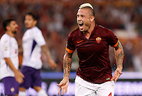 Calcio, Serie A: Roma vs Fiorentina. Roma, stadio Olimpico, 30 agosto 2014.<br /> Roma midfielder Radja Nainggolan, of Belgium, celebrates after scoring during the Italian Serie A football match between AS Roma and Fiorentina at Rome's Olympic stadium, 30 August 2014.<br /> UPDATE IMAGES PRESS/Riccardo De Luca