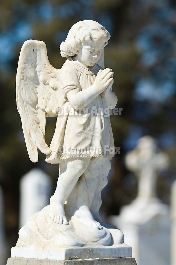Angel headstone at grave of baby in the cemetery, Austin, Nev.
