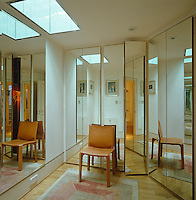 A leather chair in a mirrored dressing room