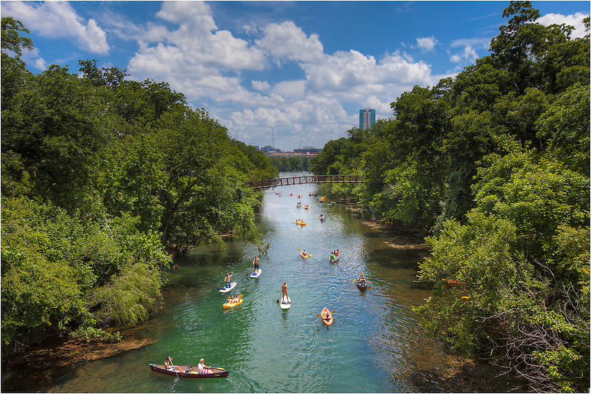 I captured this image from a pedestrian bridge that spans a small tributary (Barton Creek) feeding into Lady Bird Lake. One of favorite pastimes of locals in Austin, Texas, is enjoying the cool waters and hike and bike trails of Zilker Park.