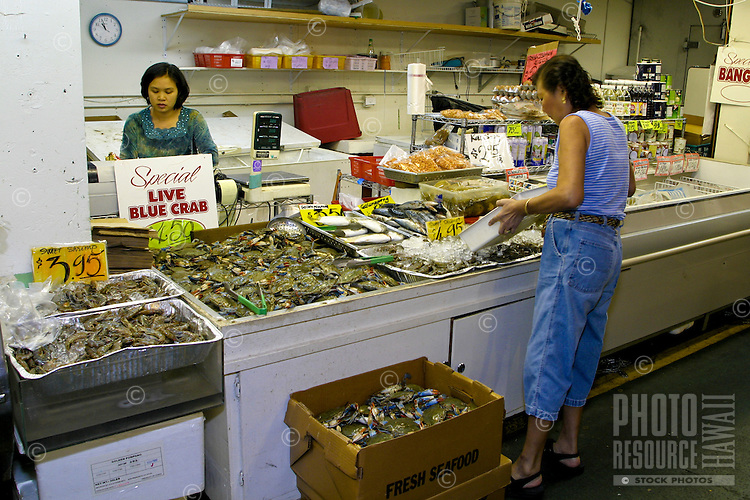 Open markets offering great food, island produce, fresh seafood and gifts can all be found in bustling Chinatown. Located near downtown Honolulu, Oahu.