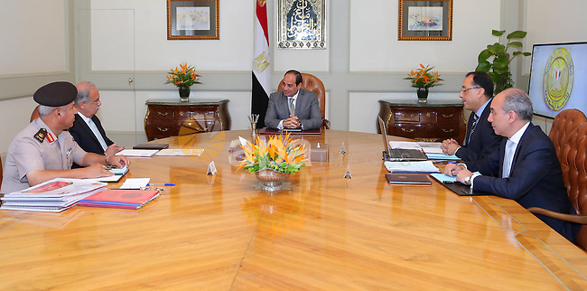 Egyptian President Abdel Fattah al-Sisi meets with Egyptian Prime Minister Sharif Ismail and Mustafa Madbouli, Housing Minister, in Cairo, Egypt, on July 10, 2016. Photo by Egyptian President Office