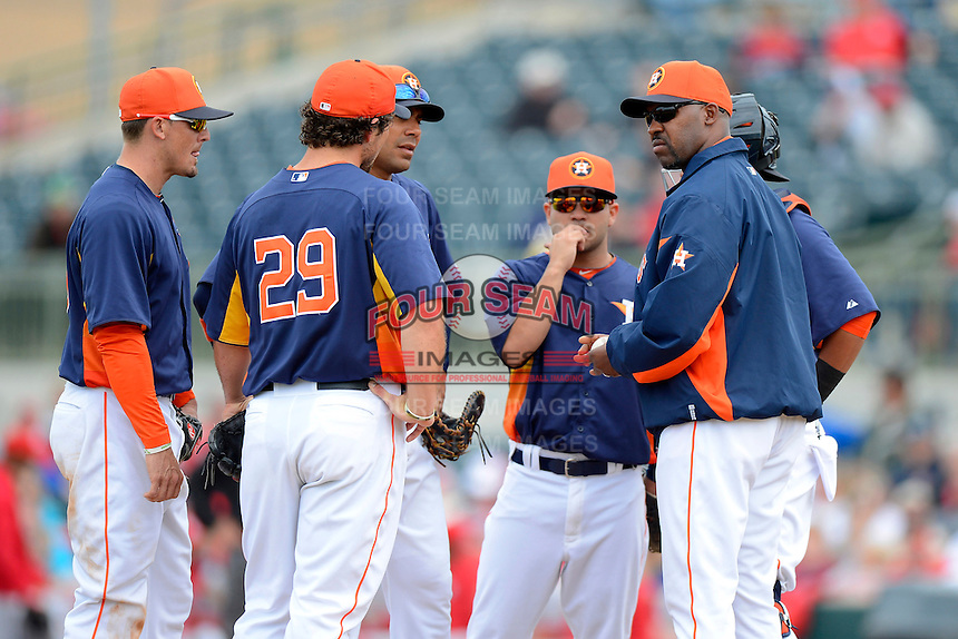 Houston Astros manager Bo Porter #16 makes a pitching change as Brett Wallace #29, Tyler Greene #23, Carlos Pena #12, Jose Altuve #27, and Carlos Corporan #22 look on during a Spring Training game against the St. Louis Cardinals at Osceola County Stadium on March 1, 2013 in Kissimmee, Florida.  The game ended in a tie at 8-8.  (Mike Janes/Four Seam Images)