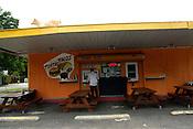June 02, 2009. Durham, NC..Andrew Kirman picks up his order from La Vaquita, a taqueria located in Durham.