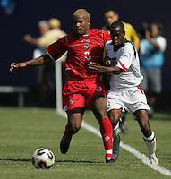 July 24, 2005: East Rutherford, NJ, USA:  USMNT forward DaMarcus Beasley (7) tries to get around Panamanian defender Luis Moreno (3) during the CONCACAF Gold Cup Finals at Giants Stadium.  The USMNT won 3-1 on penalty kicks.
