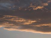Late evening sun on clouds, Arnside, Lancashire, UK.