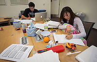John Ugai '13 and Piper Galt '14 are surrounded by study materials in Rangeview as they study for finals, May 7, 2013. (Photo by Marc Campos, Occidental College Photographer)