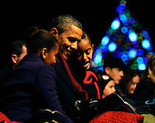United States President Barack Obama and daughters Sasha, left, and Malia, right, participate in the 2011 National Christmas Tree Lighting on the Ellipse in Washington, DC, on Thursday, December 1, 2011. .Credit: Roger L. Wollenberg / Pool via CNP