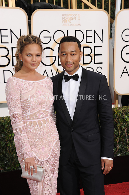 WWW.ACEPIXS.COM<br /> <br /> January 11 2015, LA<br /> <br /> Model Chrissy Teigen (L) and singer John Legend arriving at the 72nd Annual Golden Globe Awards at The Beverly Hilton Hotel on January 11, 2015 in Beverly Hills, California<br /> <br /> By Line: Peter West/ACE Pictures<br /> <br /> <br /> ACE Pictures, Inc.<br /> tel: 646 769 0430<br /> Email: info@acepixs.com<br /> www.acepixs.com