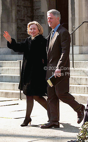 United States President Bill Clinton and first lady Hillary Rodham Clinton wave to photographers, January 25, 1998 as they depart Sunday services at the United Methodist Foundry Church in Washington, DC.<br /> Credit: CNP