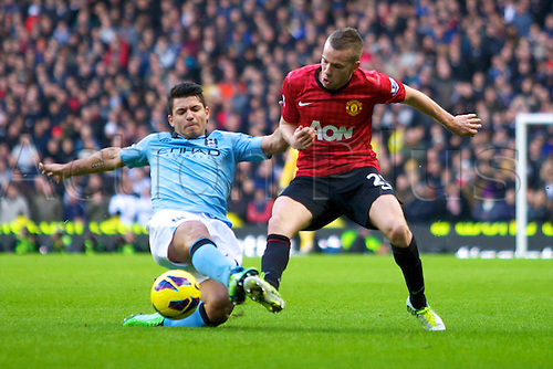 09.12.2012 Manchester, England. Manchester City's Argentinean forward Sergio Agüero and Manchester United's English midfielder Tom Cleverley in action during the Premier League game between Manchester City and Manchester United from the Etihad Stadium. Manchester United scored a late winner to take the game 2-3.