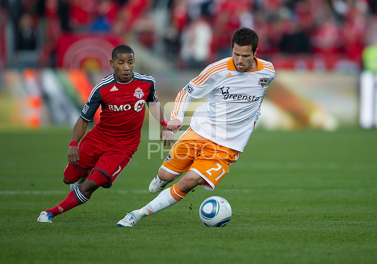 07 May 2011: Toronto FC forward Joao Plata #7 and Houston Dynamo defender Hunter Freeman #21 in action during an MLS game between the Houston Dynamo and the Toronto FC at BMO Field in Toronto, Ontario..Toronto FC won 2-1.