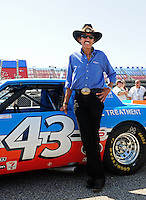 Apr 24, 2009; Talladega, AL, USA; NASCAR Sprint Cup Series former driver Richard Petty with the car he won his 200th career race with during practice for the Aarons 499 at Talladega Superspeedway. Mandatory Credit: Mark J. Rebilas-