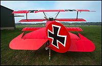 BNPS.co.uk (01202 558833)<br /> Pic: PhilYeomans/BNPS<br /> <br /> The Fokker Dreidecker before it was ready to fly.<br /> <br /> The feared Fokker Dreidecker of the Red Baron has finally flown over Britian skies - after British based German doctor 'Baron' Peter von Brueggemann spent 9 years building a replica in his garage.<br /> <br /> The German GP based in Norfolk has spent 9 years building a Fokker triplane as a tribute to infamous WW1 Ace Manfred von Ricthofen, who terrorised the skies over the Western front during the first war.<br /> <br /> Dr Peter Brueggemann, 53, fufilled his childhood dream and emulated the notorious German fighter Ace when his hand built Dreidecker finally took off this week.<br /> <br /> Dr Brueggemann has even acquired the title Baron from the independent territory of Sealand so he can take to the skies as Baron Peter von Brueggemann in homage to his idol.<br /> <br /> The GP at the Holt Medical Practice in Norfolk finally reached for the sky at Felthorpe airfield near Norwich this week in front of nervous friends and family after thousands of hours spent crafting the aircraft.<br /> <br /> The father-of-two, who has lived in England with wife Sue for 20 years, has been taking flying lessons since his project began.