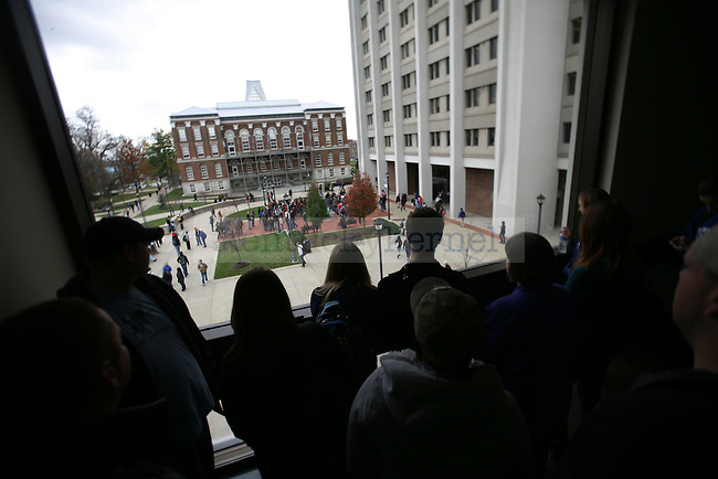 UK students and faculty watch from White Hall Classroom Building as the protest against the newly implemented tobacco ban continues at Patterson Office Tower on Thursday, Nov. 19, 2009. Photo by Adam Wolffbrandt | Staff