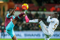 Enner Valencia of West Ham United and Raheem and `Modou Barrow of Swansea in action during the Barclays Premier League match between Swansea City and West Ham United played at the Liberty Stadium, Swansea  on December 20th 2015