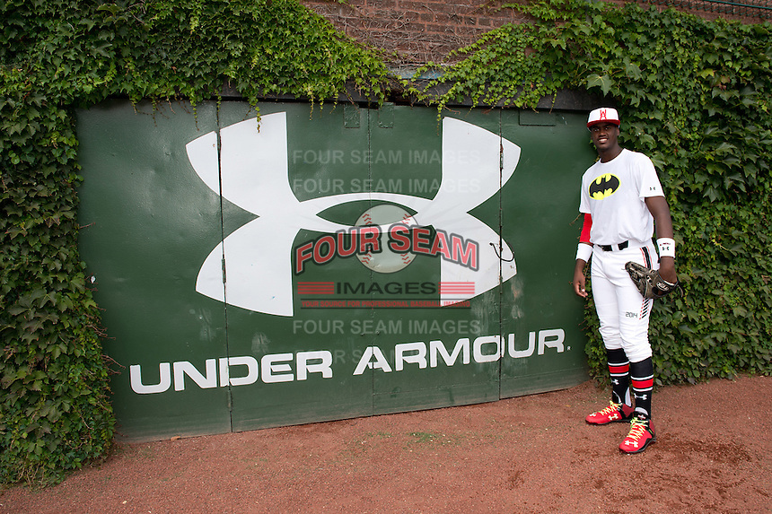 Franklin Reyes (34) of San Cristobal, Dominican Republic representing the Dominican Prospect League poses for a photo during practice before the Under Armour All-American Game on August 16, 2014 at Wrigley Field in Chicago, Illinois.  (Mike Janes/Four Seam Images)
