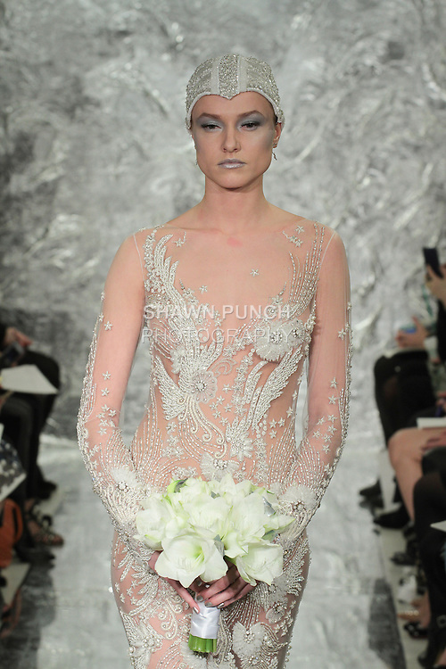 "Model Aida Aniulyte walks runway in Nyota - an ivory hand embroidered ""Galaxy"" bridal gown from the Theia Spring 2017 bridal collection by Don O'Neill, during New York Bridal Fashion Week Spring Summer 2017 on April 14, 2016."